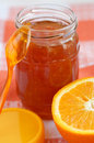 Orange homemade jam in a glass jar Royalty Free Stock Image