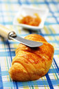 Orange jam and fresh croissant Royalty Free Stock Images