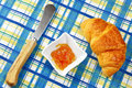 Orange jam and fresh croissant Stock Photo