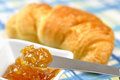 Orange jam and fresh croissant Royalty Free Stock Image