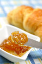 Orange jam and fresh croissant Royalty Free Stock Photos