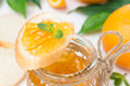 Orange jam in a glass jar and baguette piece of close up Stock Image