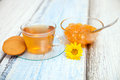 Orange jam and herbal tea on wooden table Royalty Free Stock Images