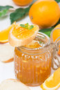 Orange jam in a jar and fresh bread close up glass vertical Royalty Free Stock Photography
