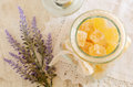 Orange jellies and lavender homemade sugared in glass jar on vintage lace doily Royalty Free Stock Photos