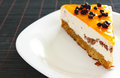 Orange jelly cake with mousse and cranberries Stock Photo
