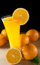 Orange juice on black background Stock Image