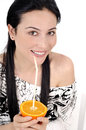 Orange juice drinking woman smiling showing lemon young beautiful mixed race asian caucasian model Royalty Free Stock Photography