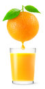 Orange juice with a drop of over glass of over white background Royalty Free Stock Photography