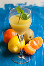 Orange juice and fresh fruits Stock Photography