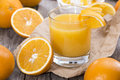 Orange juice with fresh fruits Royalty Free Stock Photos