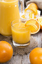 Orange juice with fresh fruits Stock Photography