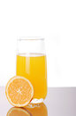 Orange juice fresh in a glass with a half Stock Photos