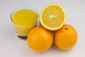 Orange juice fresh made in glas with oranges Royalty Free Stock Images