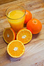 Orange juice fresh on a wood table Stock Images