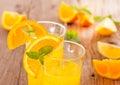 Orange juice fresh on wooden background Royalty Free Stock Images