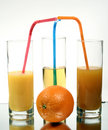 Orange juice into a glass Stock Photography