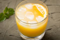 Orange juice in glass with mint, fresh fruits. selective focus, Royalty Free Stock Photo