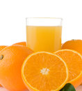 Orange juice in glass and slices on white Stock Image