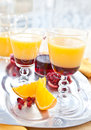 Orange juice with grenadine sirup and fruit Stock Photo