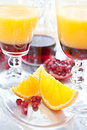 Orange juice with grenadine sirup and fruit Royalty Free Stock Photo