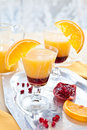 Orange juice with grenadine sirup and fruit Stock Image