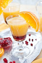 Orange juice with grenadine sirup and fruit Stock Images