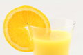 Orange juice macro fuzzy soft drink with a slice of along the edge of the glass Royalty Free Stock Image
