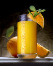 Orange juice on marble with wedge and slice Stock Image