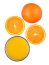Orange juice and oranges on white background top view Royalty Free Stock Photos
