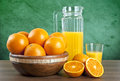 Orange juice with oranges on wooden table fresh Stock Images
