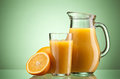 Orange juice over green Stock Images
