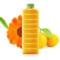 Orange juice in a plastic container jug with fresh and leaves on a white background Royalty Free Stock Image