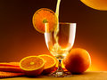 Orange juice poured into a glass Stock Photography