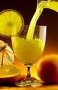 Orange juice poured into a glass Stock Photo
