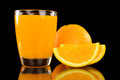 Orange juice and slice isolated on black background Royalty Free Stock Photography