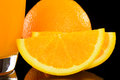 Orange juice and slice isolated on black background Stock Photo