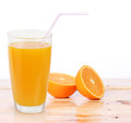 Orange juice and slices on wood a Royalty Free Stock Photography
