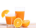 Orange juice and slices on wood a Stock Image