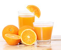 Orange juice and slices on wood a Stock Photography