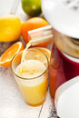 Orange juice slow juicer and Stock Photo