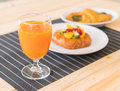orange juice with spinach croissant and mixed fruits danish Royalty Free Stock Photo