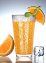 Orange juice with water drops on white Royalty Free Stock Images