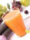 Orange juice with weights and fresh fruits Stock Photography