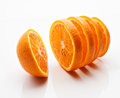 Orange juicy and ripe sliced pieces on white background Royalty Free Stock Images