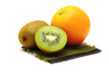 Orange and kiwi fresh fruit on white background Royalty Free Stock Images