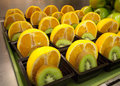 Orange and kiwi fruit cups fresh for school lunch in cafeteria Stock Photo