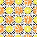 Orange and kiwi slices seamless vector pattern. Abstract summer fruit background with black polka dots on white. Royalty Free Stock Photo