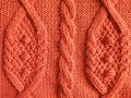 Orange knitting Royalty Free Stock Images