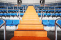 Orange ladder and grandstand at large football stadium blue Royalty Free Stock Image